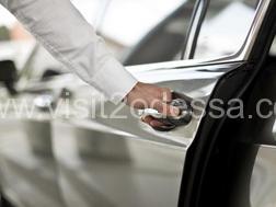 English-speaking driver in Odessa opens cars door