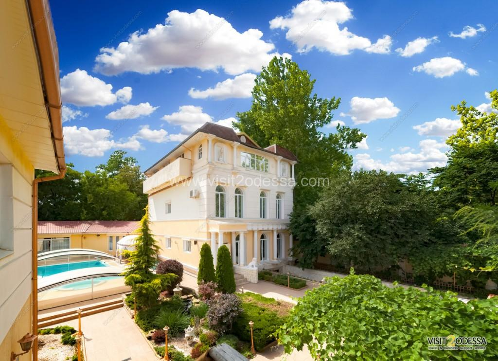 Villa house in Arcadia, Odessa with the open pool and a summer garden.