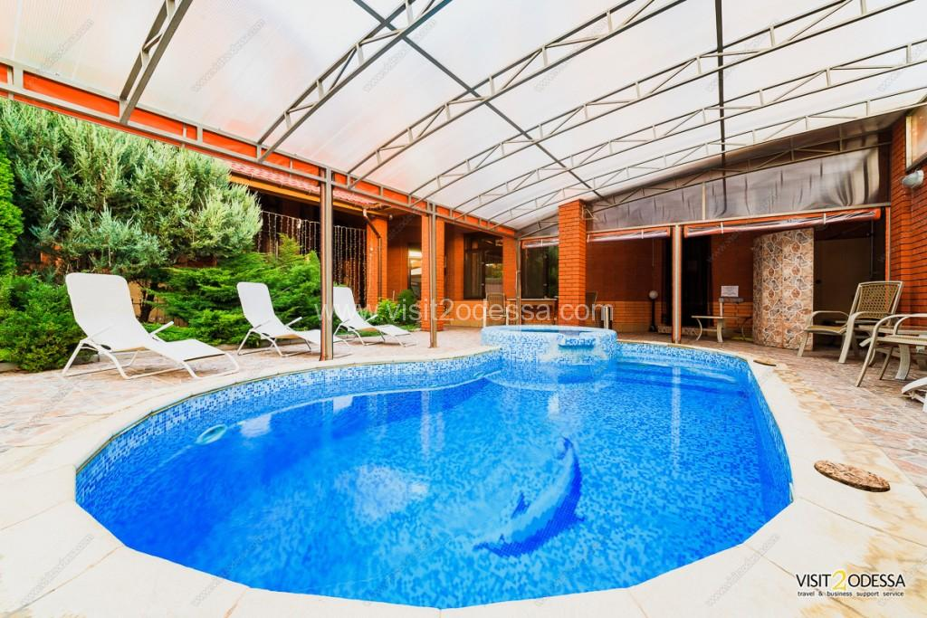 The pool with heating, in the territory, near the Odessa vip villa house.