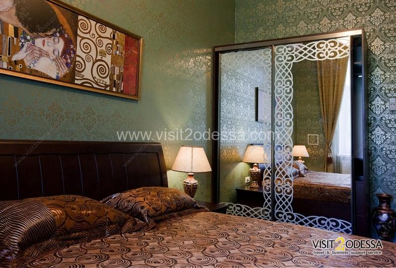 Bedroom with a double bed, in the Odessa gardens.